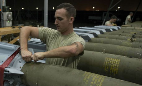 An airman attaches fins to GBU-12 Paveway II laser-guided bombs at Incirlik Air Base, Turkey, in 2016.