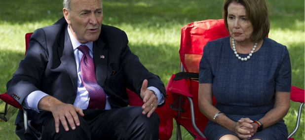 Senate Minority Leader Chuck Schumer and House Minority Leader Nancy Pelosi speak with DREAMERS on Capitol Hill earlier this month.