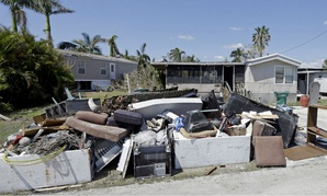 Debris from Hurricane Irma sits outside homes in Everglades City, Fla.