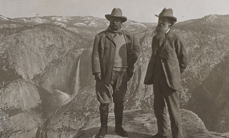 Theodore Roosevelt stands with John Muir on Glacier Point, above Yosemite Valley, California, in 1903.