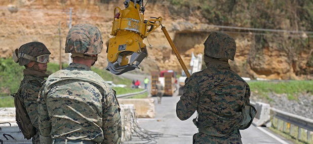 Marines conduct sling load operations using a Navy MH-53 in order to pick up barriers to strengthen the broken dam at Guajataca on Oct. 6.