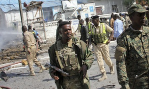 Somali security forces gather at the scene of a suicide car bomb attack on a police station in Mogadishu, Somalia Thursday, June 22, 2017.