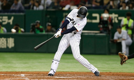 Japanese baseball player Shohei Otani hits a home run during an exhibition in 2016.