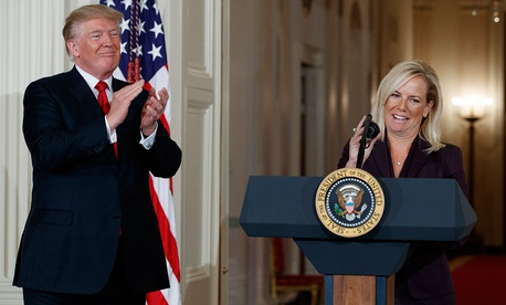 President Donald Trump applauds Kirstjen Nielsen, his nominee to be Secretary of Homeland Security, in the East Room of the White House on Oct. 12.