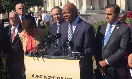 "Rep. Elijah Cummings, D-Md. (center at microphones), said: ""This lawsuit is not just about a hotel in Washington D.C. This is about the president defying a federal statute."""