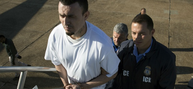 Ingmar Guandique, a documented MS-13 gang member, is escorted by ICE agents in May as he is deported to El Salvador.