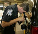 A U.S. Customs and Border Protection officer inspects a vehicle.