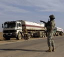 U.S. Army Sgt. Tommy Williams provides security during a fuel truck inspection near Riyadh, Iraq.