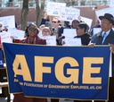 Workers protested budget cuts Wednesday outside SSA office in Baltimore.