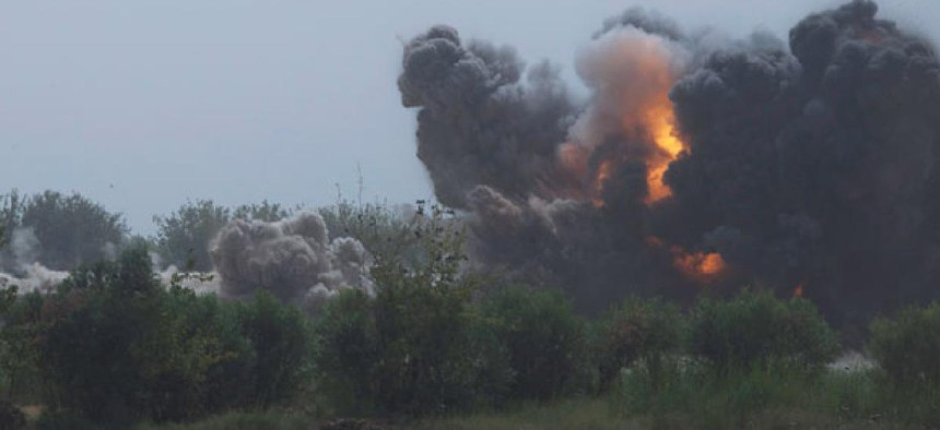 A U.S. bomb destroys a Taliban compound in Afghanistan in 2011.