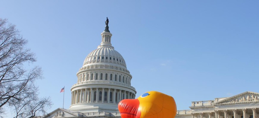 The Capitol grounds had a temporary lawn ornament Wednesday as Oxfam America activists dressed as Senate and House leaders and danced around a giant, inflatable duck to ask the lame duck session of Congress to protect foreign aid programs.