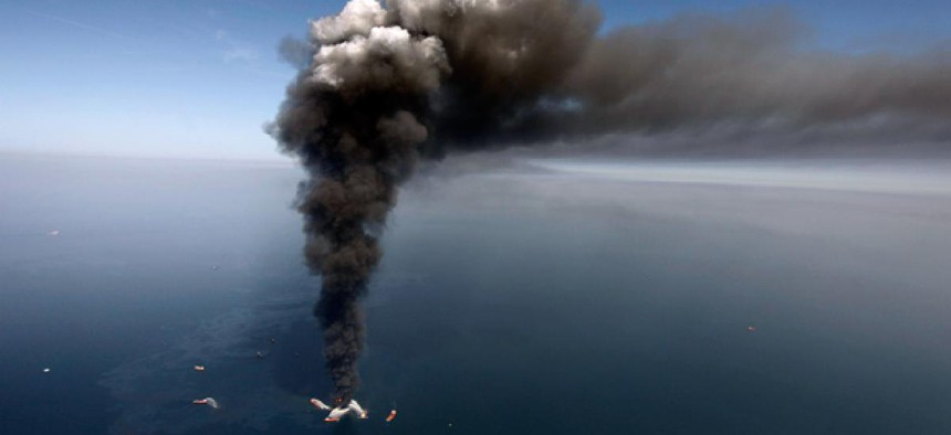 A large plume of smoke rises from fires on BP's Deepwater Horizon offshore oil rig.