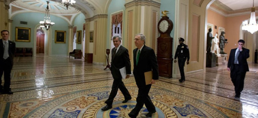 Sen. Mike Johanns, R-Neb., left, walks with Minority Leader Sen. Mitch McConnell, R-Ky., to the Senate floor Tuesday.