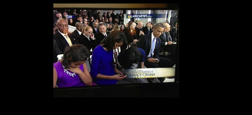 Distractions abound: In an image from the inauguration, the entire Obama family is seen using their smartphones.