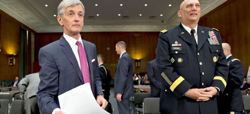 Army Secretary John McHugh, left, and Army Chief of Staff Gen. Ray Odierno, arrive on Capitol Hill  to testify for the hearing on the Defense Department budget requests for Fiscal 2014