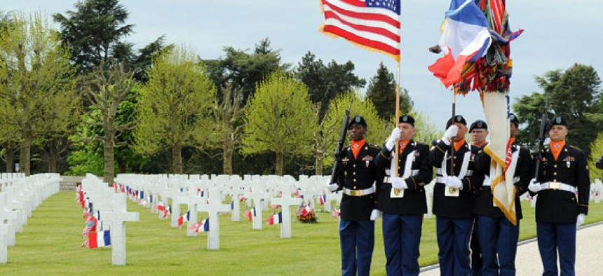 U.S. Army color guard marches at May 26 observation of Memorial Day at the Somme American Cemetery and Memorial in Bony, France.