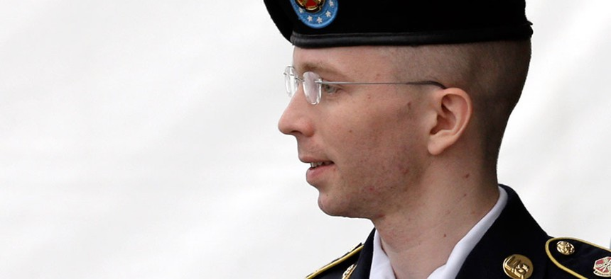 Army Pfc. Bradley Manning is escorted out of a courthouse in Fort Meade, Md.