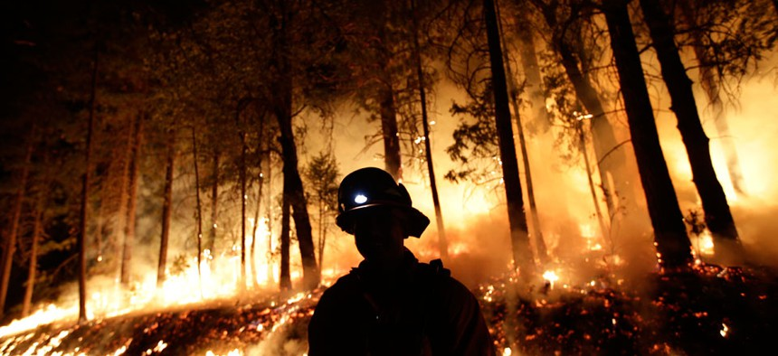 Firefighter helps battle the Rim Fire near Yosemite National Park, Calif.