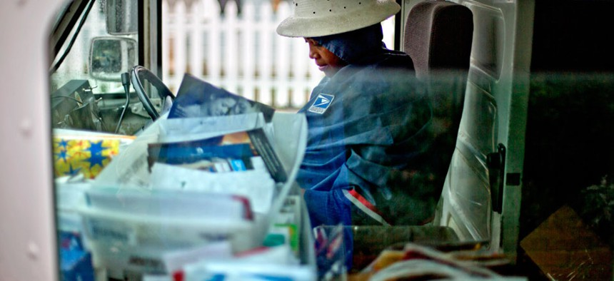 A postal worker starts her route in Atlanta in February.