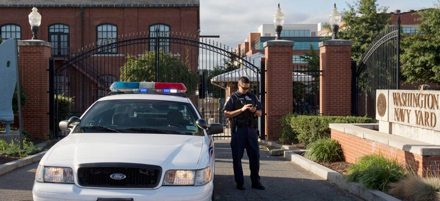 A police officer waits outside the Navy Yard Tuesday.