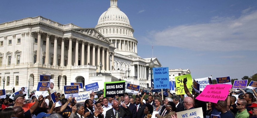 Protesters gathered at the Capitol Sunday to demonstrate against the shutdown.
