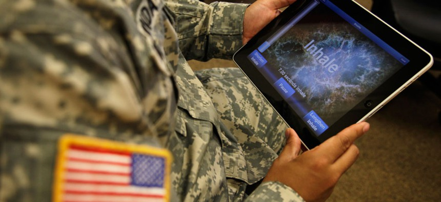 A man at Joint Base Lewis-McChord uses a program for tablet computers and smart phones that is designed to help calm symptoms of post-traumatic stress and traumatic brain injury in 2011.