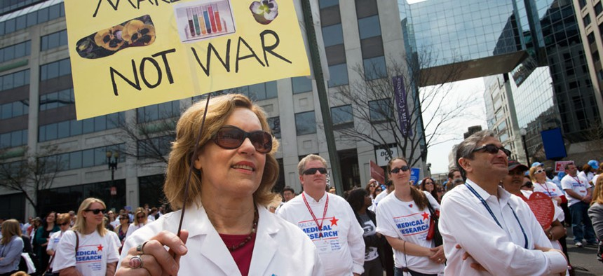 """Lorraine Gudas, chair of pharmacology at Weill Cornell Medical College, and others, participate in a """"Rally for Medical Research,"""" Monday, April 8, 2013, in Washington."""