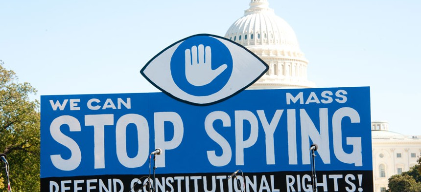 A sign is seen at a protest against the NSA in Washington in 2013.