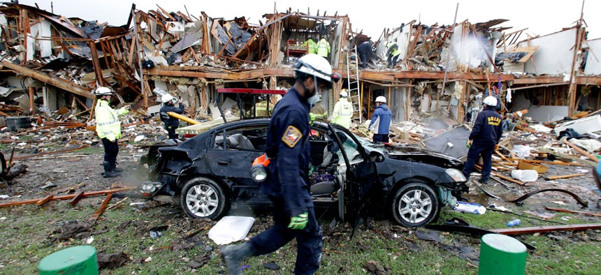 Firefighters conduct search and rescue of an apartment destroyed by an explosion at the the West Fertilizer Co. in West, Texas.