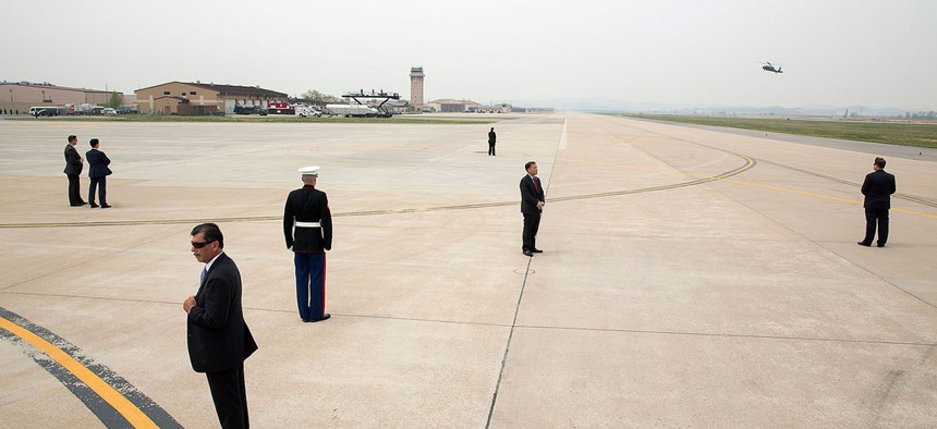 U.S. Secret Service agents are positioned on the tarmac as President Barack Obama arrives aboard Marine One in South Korea last year.