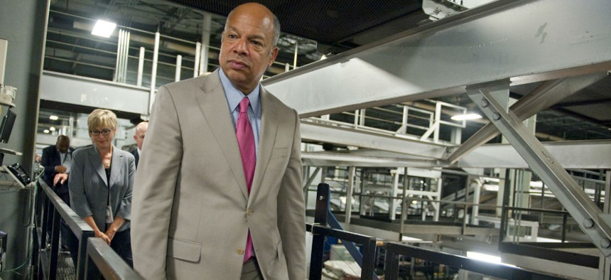 """House members are growing impatient with DHS Secretary Jeh Johnson's ongoing """"Unity of Effort"""" initiative. Johnson is shown here touring an automated package handling facility in Kentucky last summer."""