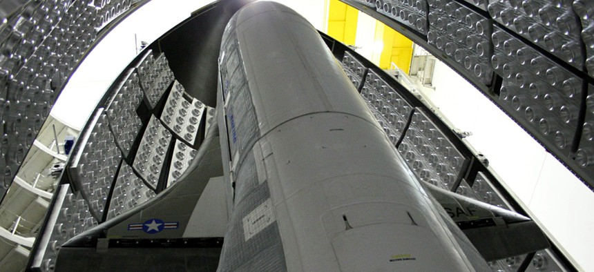 The X-37B, tucked inside the aerodynamic shell that will protect it on its way to space.