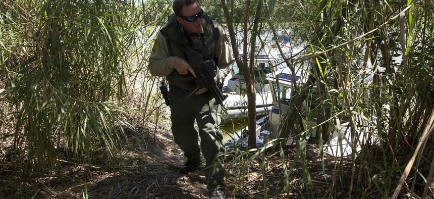 An agent patrols along the Rio Grande River.