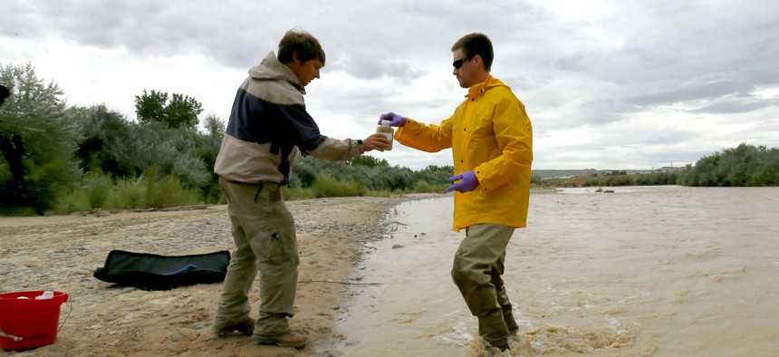 State officials take a sample from the San Juan River in Utah, which was affected by the spill.