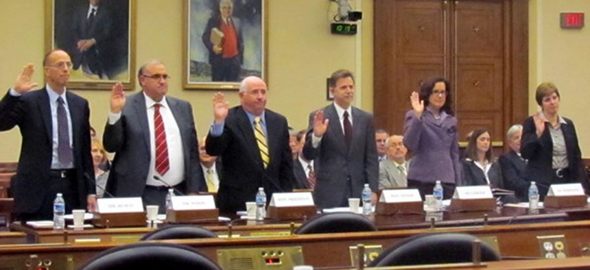 Recovery board members are sworn in to testify at a congressional hearing on accountability and transparency efforts in 2011.