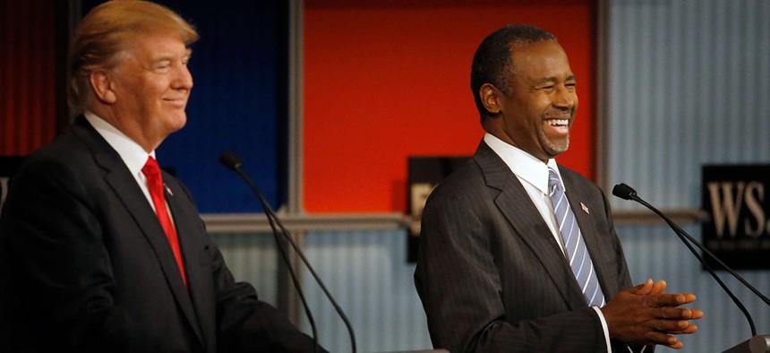 Donald Trump and Ben Carson laugh during Republican presidential debate on Nov. 10.