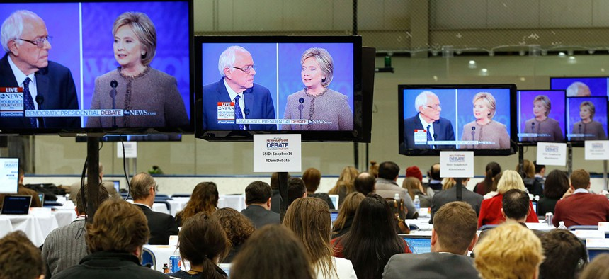 Journalists work at the media filing center Saturday during the debate.