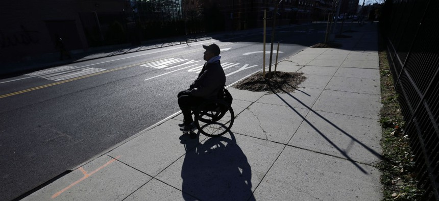 Paralyzed Army veteran Gene Laureano sits in his wheelchair Dec. 16, 2015, in Bronx, N.Y.