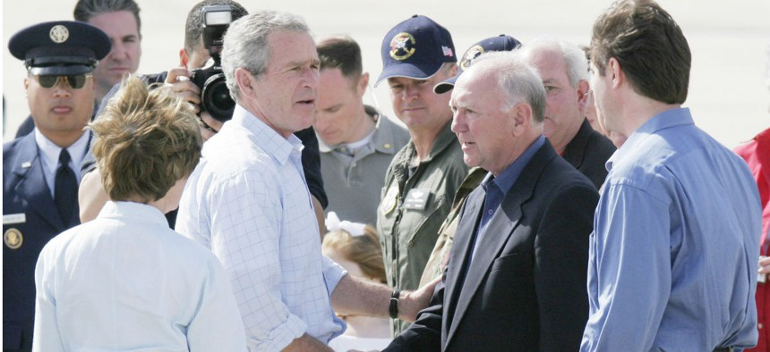 President George W. Bush greets the mayors of Biloxi and Gulfport, Miss., in March 2006, months after Hurricane Katrina devastated the Gulf Coast.