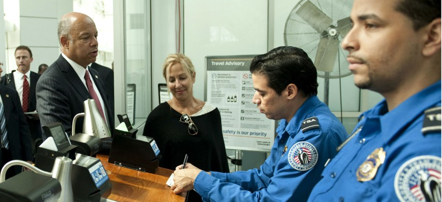 DHS Secretary Jeh Johnson and his wife, Dr. Susan DiMarco, pass through TSA security at John F. Kennedy International Airport in September 2014.