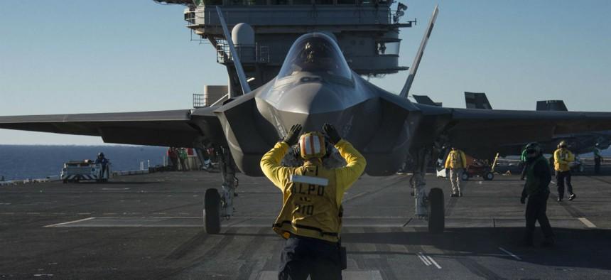 An F-35C Lightning II carrier variant is prepared for launch aboard the aircraft carrier USS Nimitz (CVN 68).