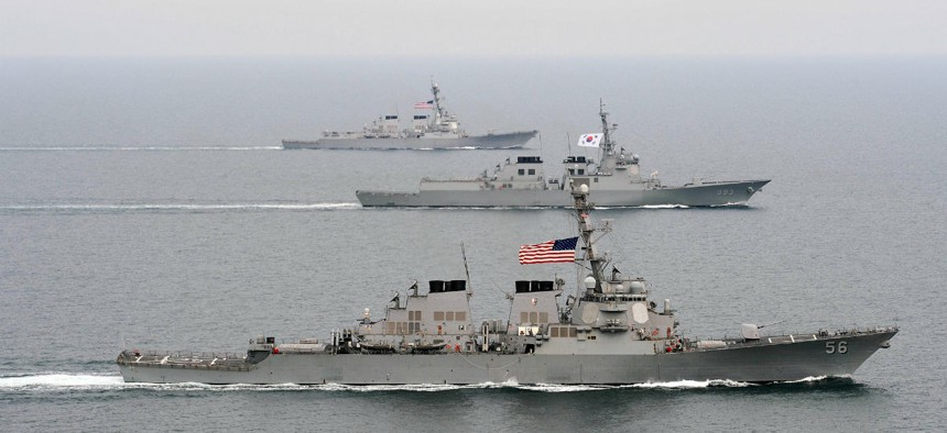 Two U.S. Navy guided missile destroyers flank a Republic of Korea destroyer during an exercise west of the Korean Peninsula.