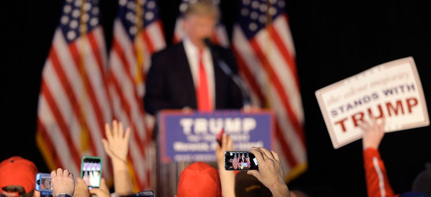 People in the audience use mobile phones to record Donald Trump as he speaks at a Rhode Island rally in April.