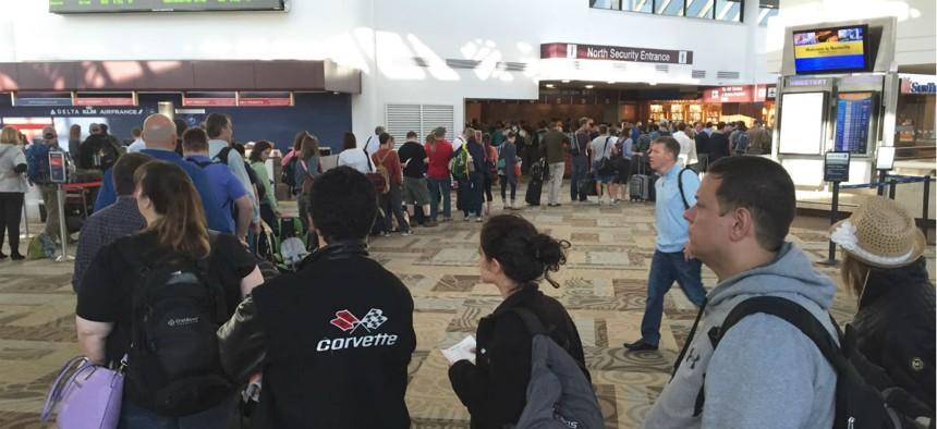 Hundreds of passengers wait in the TSA security line at Nashville International Airport April 18.