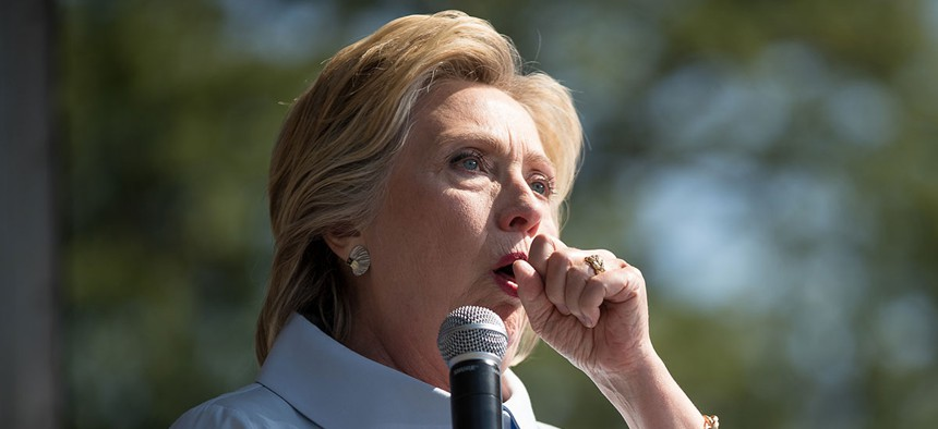 Hillary Clinton coughs during a speech in Cleveland on Monday.