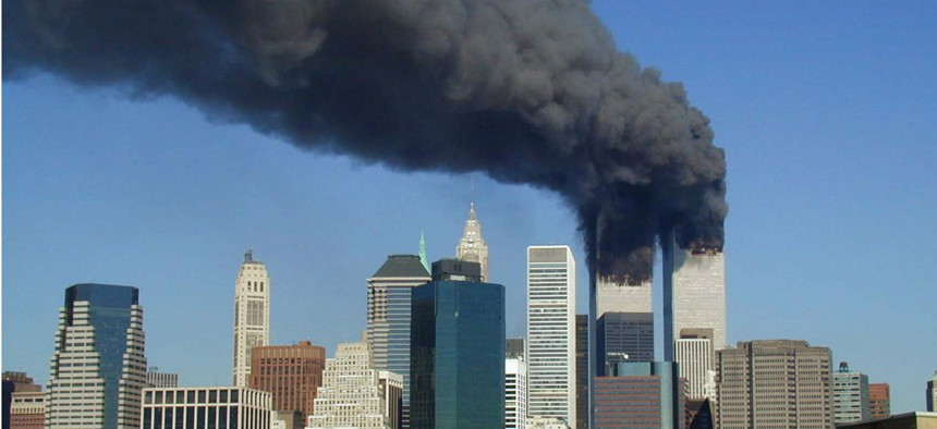 Plumes of smoke billow from the World Trade Center towers in Lower Manhattan after the 9/11 attack.