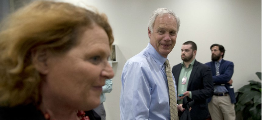 Sen. Heidi Heitkamp, left, spearheaded a letter from 50 lawmakers to Sen. Ron Johnson, left, and other authors of a postal reform bill, to register their concerns.