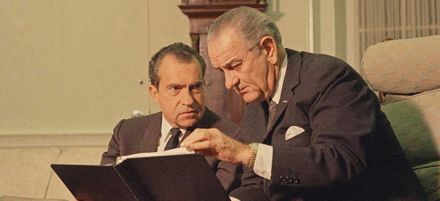 President Lyndon Johnson, right, confers with President-elect Richard Nixon in the White House, Dec. 12, 1968.