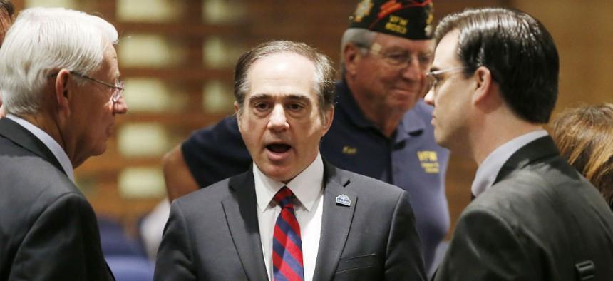 VA Undersecretary Dr. David Shulkin talks with attendees prior to testifying at a Senate Veterans' Affairs Committee field hearing in Gilbert, Ariz., in 2015.