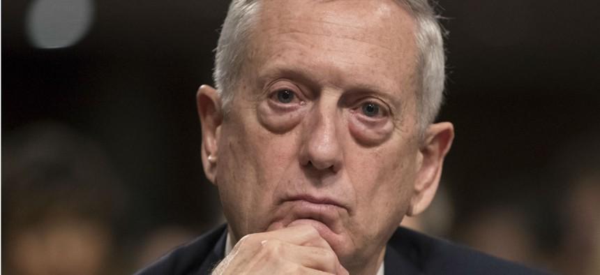 Defense Secretary-designate James Mattis listens to a question during his confirmation hearing Thursday.